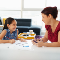 Pre-k tutor working with little girl